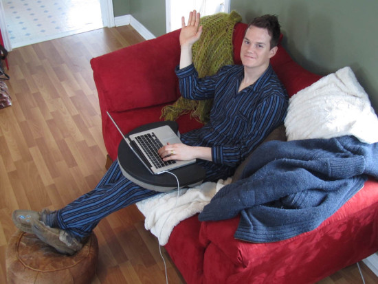 Todd working away in the 'home office' where most of the work for Global Chorus was done - On the couch in his pajamas
